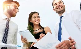 Closeup of business team discussing work documents Stock Image