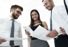 Closeup of business team discussing work documents Royalty Free Stock Photography