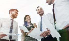 Closeup of business team discussing work documents Stock Photography