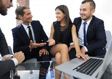 Closeup.business team holds a discussion. Sitting near the table Royalty Free Stock Image
