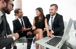 Closeup.business team holds a discussion. Sitting near the table Royalty Free Stock Photo