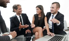 Closeup.business team holds a discussion. Sitting near the table Royalty Free Stock Photos