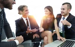 Closeup.business team holds a discussion. Sitting near the table Royalty Free Stock Images