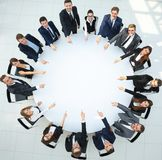 Closeup .business team pointing in the center of the table. Royalty Free Stock Image