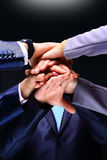 Closeup of business team putting their hands Stock Images