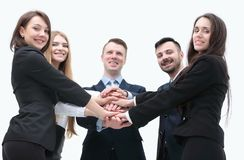 Closeup.business team shows its unity. Concept of unity. business team standing with folded hands together Royalty Free Stock Photos