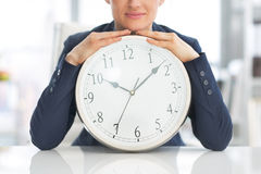Closeup on business woman with clock Stock Photography