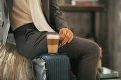 Closeup on business woman with coffee latte Royalty Free Stock Photos