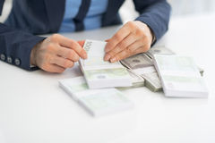 Closeup on business woman counting money Stock Photos