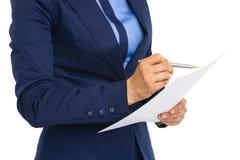 Closeup on business woman examining document Stock Image