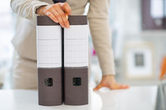 Closeup on business woman with folders Stock Photography