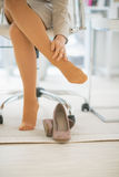 Closeup on business woman with foot pain royalty free stock photo