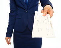 Closeup on business woman giving air tickets Royalty Free Stock Image