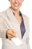 Closeup on business woman giving business card Royalty Free Stock Image