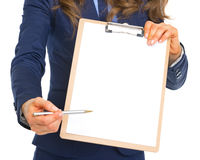 Closeup on business woman giving clipboard for sign Stock Photography
