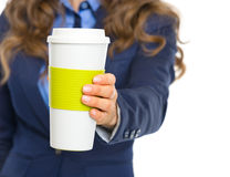 Closeup on business woman giving cup of hot beverage Royalty Free Stock Photography
