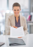 Closeup on business woman giving document Royalty Free Stock Images