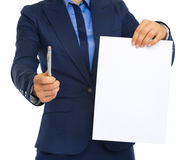 Closeup on business woman giving document and pen Royalty Free Stock Photos