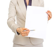 Closeup on business woman giving document for sign Royalty Free Stock Photo