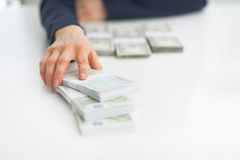 Closeup on business woman giving money packs Royalty Free Stock Images