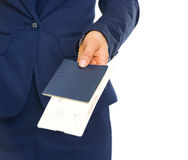 Closeup on business woman giving passport with air tickets Stock Image