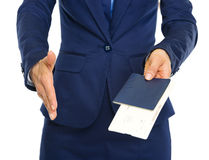 Closeup on business woman giving passport with air tickets. And stretching hand for handshake Stock Photo