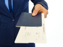 Closeup on business woman giving passport Royalty Free Stock Images