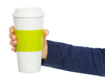 Closeup on business woman hand holding cup of hot beverage Royalty Free Stock Image
