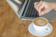 Closeup of business woman hand mix coffee on background Royalty Free Stock Photos
