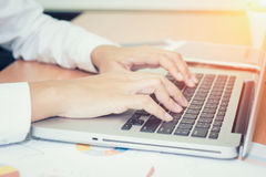 Closeup of business woman hand typing on laptop stock image