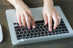 Closeup of business woman hand typing on laptop keyboar Stock Photography