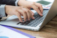 Closeup of business woman hand typing Stock Photo