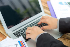 Closeup of business woman hand typing Royalty Free Stock Photo