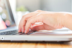 Closeup of business woman hand typing Stock Image