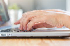 Closeup of business woman hand typing Royalty Free Stock Images