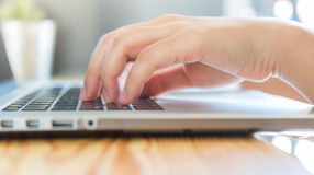 Closeup of business woman hand typing Royalty Free Stock Photography