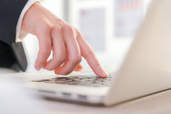 Closeup of business woman hand typing on laptop Stock Photo