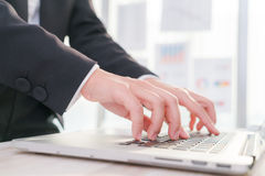 Closeup of business woman hand typing on laptop Stock Photography