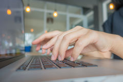Closeup of business woman hand typing on laptop keyboard . Stock Photos