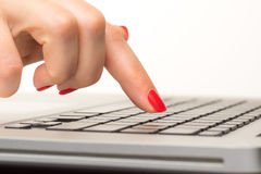 Closeup of business woman hand typing on laptop keyboard Royalty Free Stock Photo