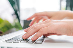Closeup of business woman hand typing on laptop keyboard . Stock Photo