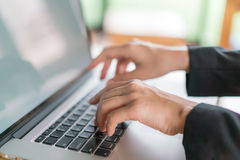 Closeup of business woman hand typing on laptop keyboard . Stock Images