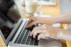 Closeup of business woman hand typing on laptop keyboard Stock Photography