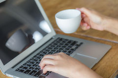 Closeup of business woman hand typing on laptop keyboard Royalty Free Stock Photography