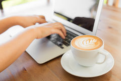 Closeup of business woman hand typing on laptop keyboard Royalty Free Stock Photos