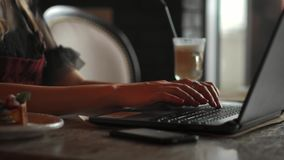 Closeup of business woman hand typing on laptop keyboard. Closeup of a female hands busy typing on a laptop. Woman`s stock footage
