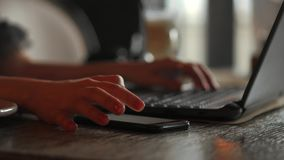 Closeup of business woman hand typing on laptop keyboard. Closeup of a female hands busy typing on a laptop. Woman`s stock video footage