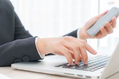Closeup of business woman hand typing on laptop keyboard with  m Stock Image