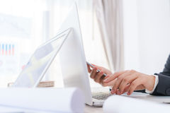 Closeup of business woman hand typing on laptop keyboard with Stock Photography