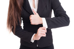 Closeup with business woman hands adjusting shirt and suit sleev Royalty Free Stock Photography